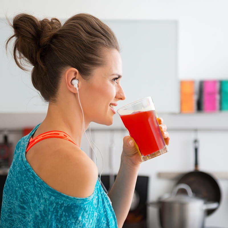 Woman drinking red drink